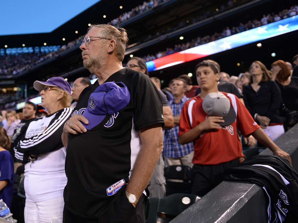 . DENVER, CO - JULY 4: Fans stood for the playing of God Bless America Friday night. It was only the third sold old crowd of the season. The Colorado Rockies hosted the Los Angeles Dodgers at Coors Field Friday night, July 4, 2014.  Photo by Karl Gehring/The Denver Post
