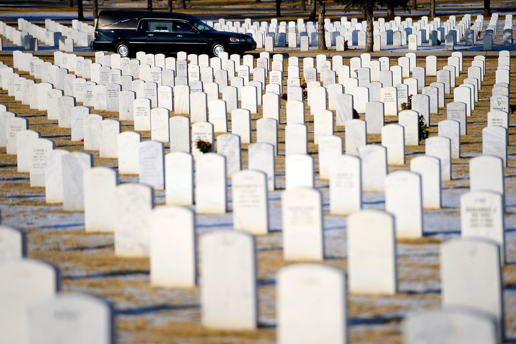 . The hearse arrives during the funeral service for Colonel Fitzroy Newsum at Fort Logan National Cemetery on Monday, January 14, 2013. Newsum, who was 94, served as a Tuskegee Airman during his military service. AAron Ontiveroz, The Denver Post