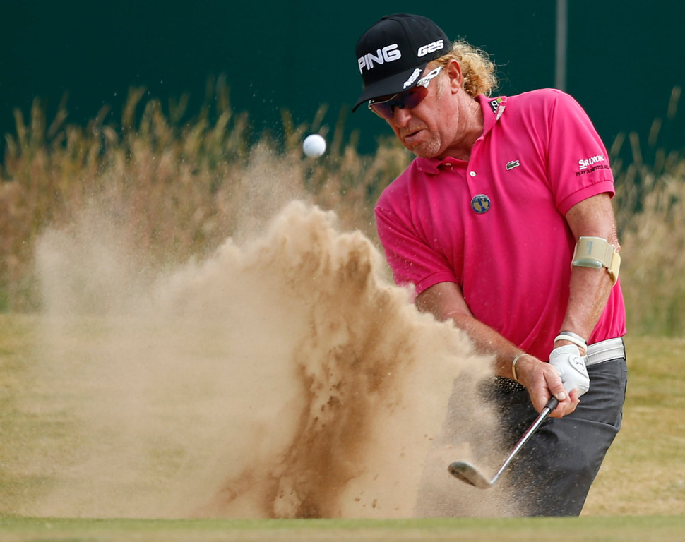 . Miguel Angel Jimenez of Spain plays out of  a sand trap on the 18th hole during the first round of the British Open Golf Championship at Muirfield, Scotland, Thursday July 18, 2013. (AP Photo/Matt Dunham)