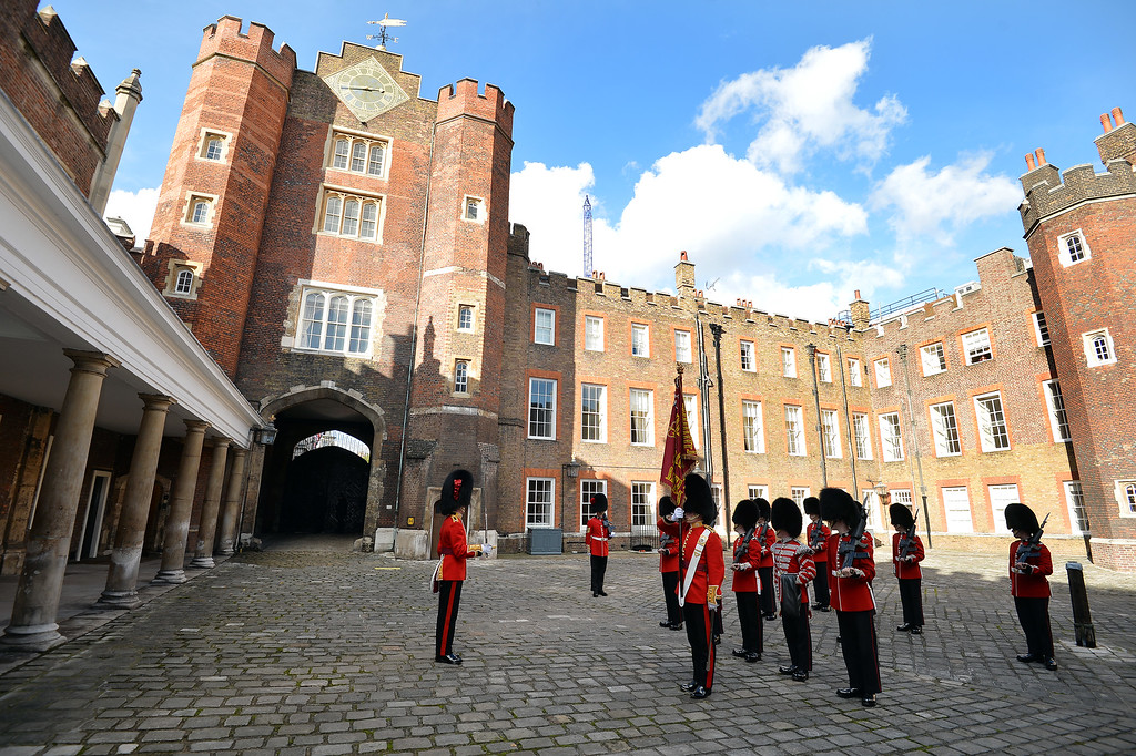 . The St James\'s Palace detachment of The Queen\'s Guard turns out in Colour Court, St James Palace, for the arrival of Queen Elizabeth II, ahead of the christening of Prince George by the Archbishop of Canterbury in the Chapel Royal, on October 23, 2013 in London, England. (Photo by John Stillwell - WPA Pool /Getty Images)