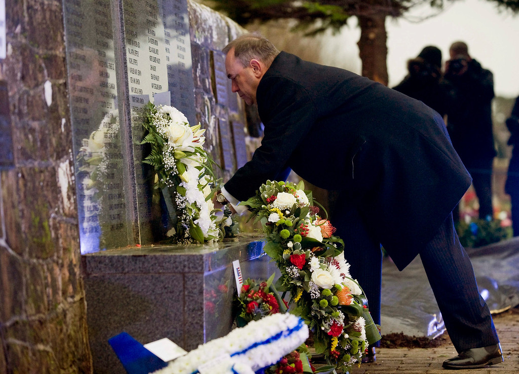 . Scotland\'s First Minister Alex Salmond places flowers at the memorial during a ceremony at Dryfesdale Cemetery in Lockerbie, Scotland, 21 December 2013.  EPA/BRIAN STEWART