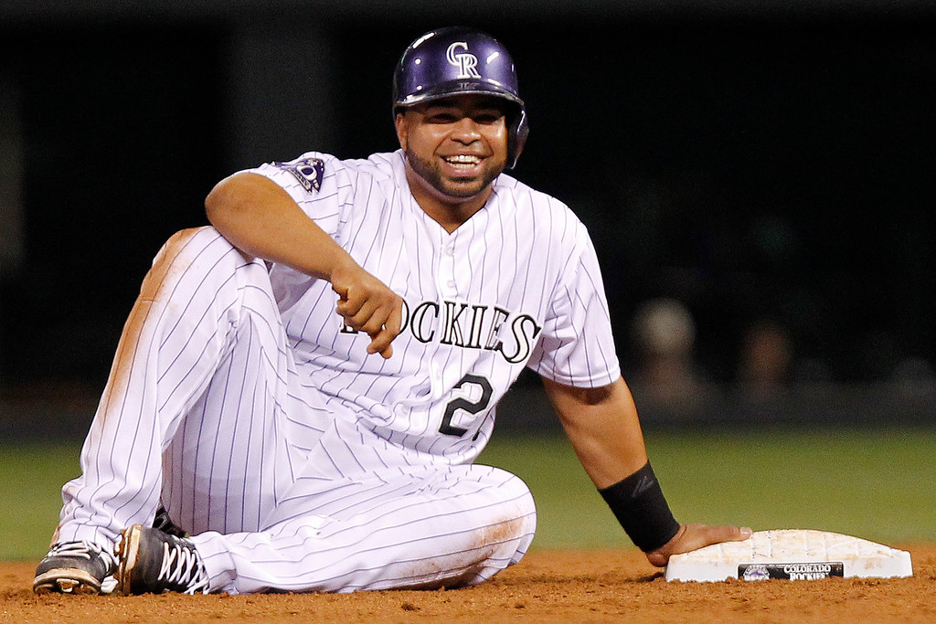 . Colorado Rockies\' Wilin Rosario reacts after safely sliding into second on an error by San Francisco Giants\' Brandon Crawford during the sixth inning of a baseball game, Wednesday, Aug. 28, 2013, in Denver. (AP Photo/Barry Gutierrez)