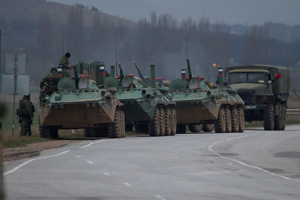 . Russian armored personnel carriers and a truck are parked on the side of the road near the town of Bakhchisarai, Ukraine, Friday, Feb. 28, 2014. The vehicles were parked on the side of the road near the town of Bakhchisarai, apparently because one of them had mechanical problems. (AP Photo/Ivan Sekretarev)