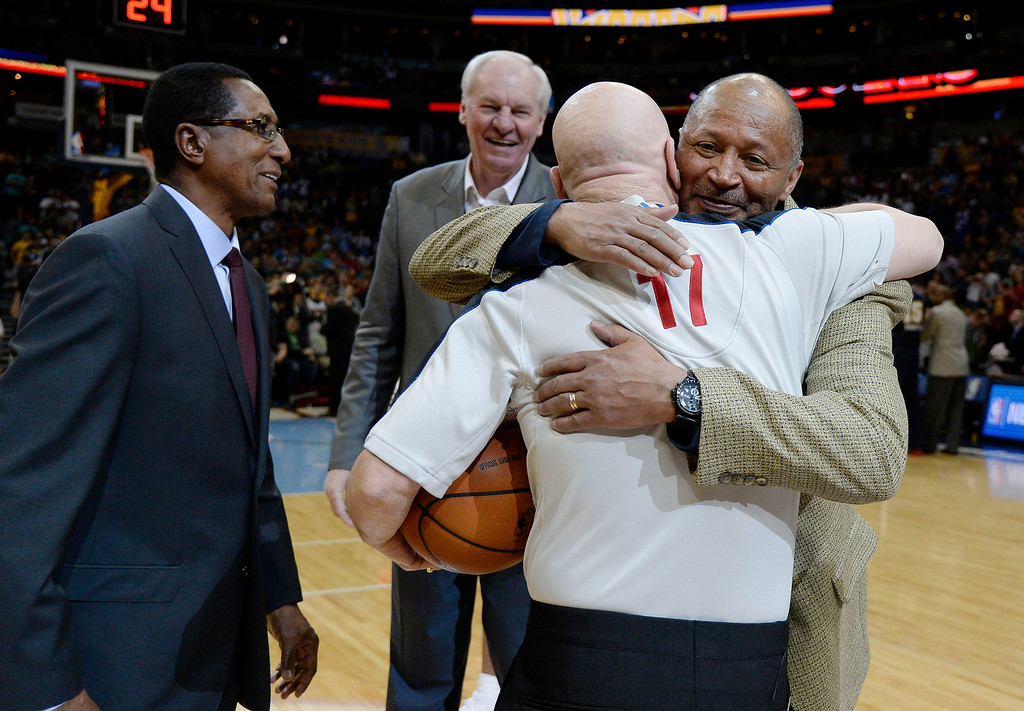 . Former Denver Nuggets player Mike Evans gets a hug from Joe Crawford as Gene Littles and Dan Issel look on before the game against the Los Angeles Clippers  March 17, 2014 at the Pepsi Center. (Photo by John Leyba/The Denver Post)