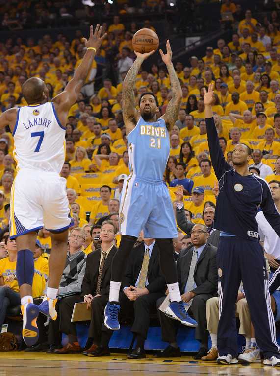 . Wilson Chandler (21) of the Denver Nuggets takes a shot over Carl Landry (7) of the Golden State Warriors during the first quarter  in Game 6 of the first round NBA Playoffs May 2, 2013 at Oracle Arena. (Photo By John Leyba/The Denver Post)
