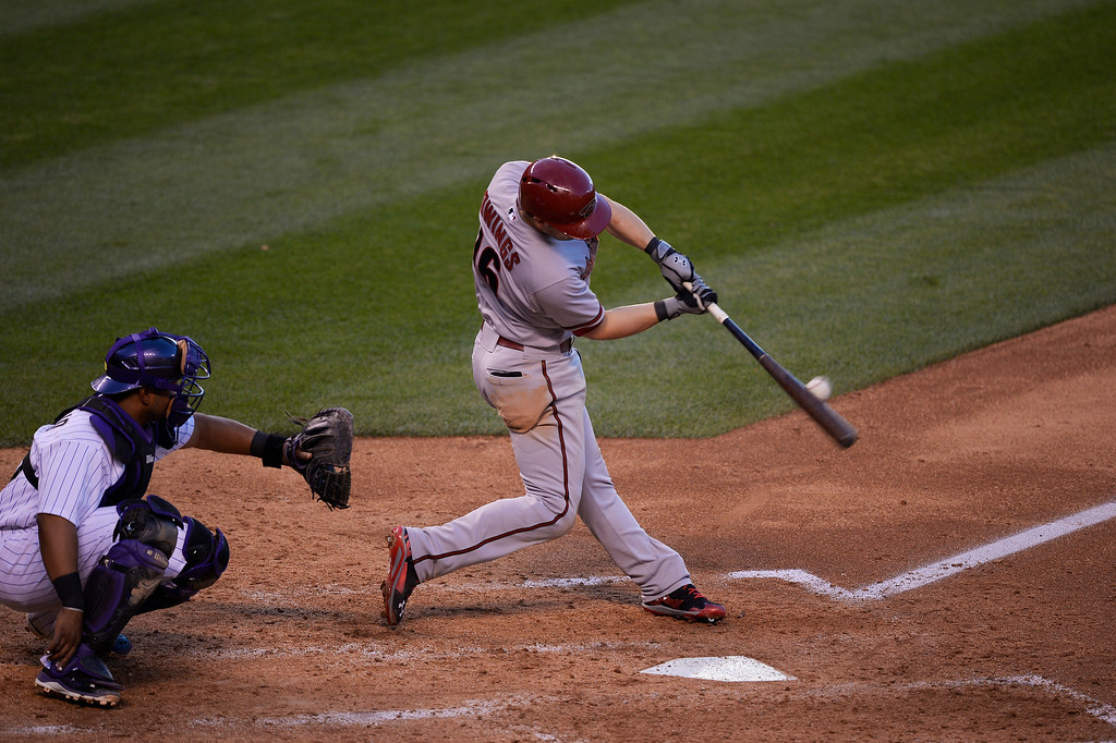 . Arizona Diamondbacks shortstop Chris Owings (16) hits a solo home run off of Colorado Rockies starting pitcher Jorge De La Rosa (29) in the 4th inning June 3, 2014 at Coors Field. Arizona Diamondbacks defatted the Colorado Rockies 4-2. (Photo by John Leyba/The Denver Post)