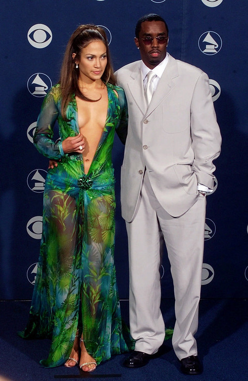 ". Sean ""Puffy\"" Combs and singer Jennifer Lopez pose backstage at the 42nd Grammy Awards in Los Angeles, Wednesday, Feb. 23, 2000. (AP Photo/Reed Saxon)"