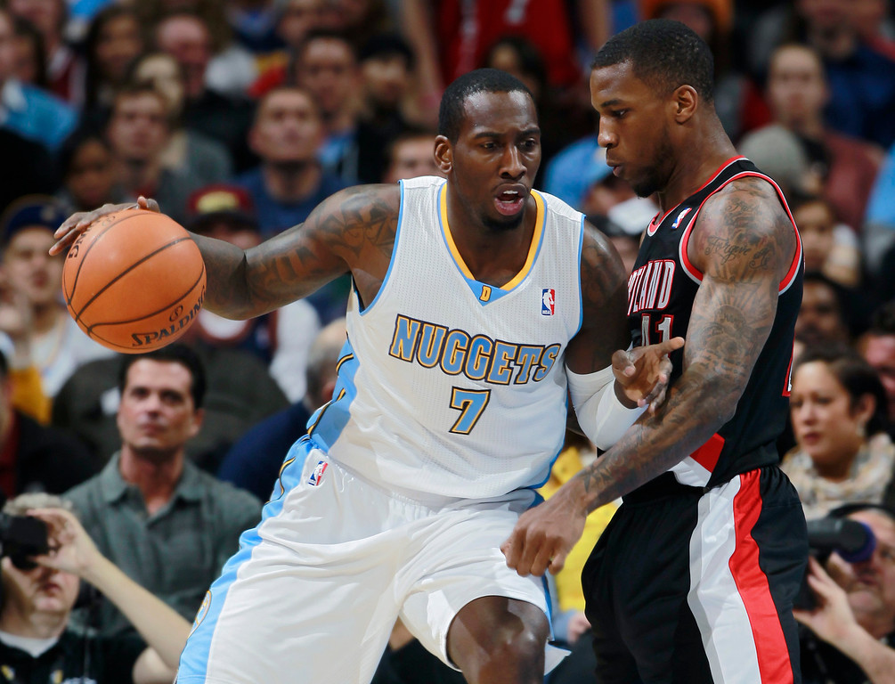 . Denver Nuggets forward J.J. Hickson, left, works ball inside or shot as Portland Trail Blazers forward Thomas Robinson covers in the first quarter of an NBA basketball game in Denver, Tuesday, Feb. 25, 2014. (AP Photo/David Zalubowski)