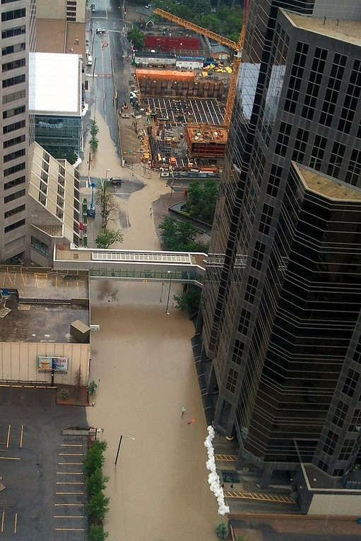 . Rising water floods the Bow River in downtown Calgary on June 21, 2013. AFP PHOTO / ADAM KLAMAR/AFP/Getty Images