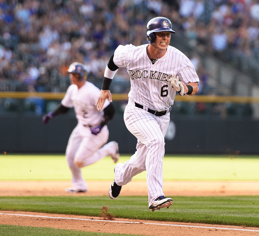 . DENVER, CO - JUNE 20: Troy Tulowtizki, left, and Corey Dickerson, right, ran the bases as Justin Morneau hit a double in the first inning to score both of them. The Colorado Rockies hosted the Milwaukee Brewers at Coors Field Friday night, June 20, 2014. Photo by Karl Gehring/The Denver Post
