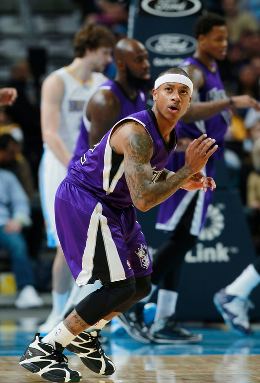 . Sacramento Kings guard Isaiah Thomas reacts after shooting basket against the Denver Nuggets in the third quarter an NBA basketball game in Denver on Sunday, Feb. 23, 2014. The Kings won 109-95. (AP Photo/David Zalubowski)