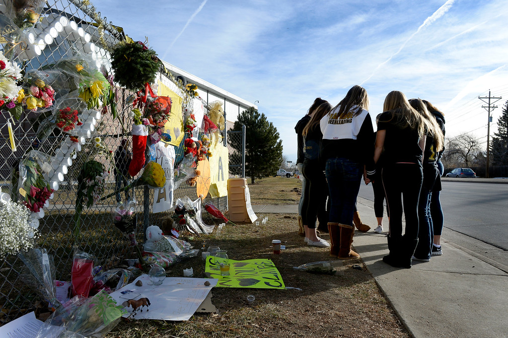 . A group of students pray outside Arapahoe High School in Centennial, CO December 19, 2013. Seniors and Juniors returned to the school for two hour periods Thursday, Sophomores and Freshmen will return on Friday.  (Photo By Craig F. Walker / The Denver Post)