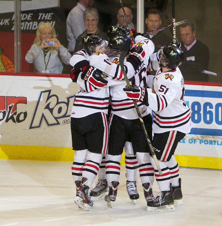 . The Portland Winterhawks celebrate around Seth Jones who scored the only goal of the first period of the Western Conference Finals  against Kamloops in Portland, Ore.,  Saturday April 20, 2013. (AP Photo/The Oregonian, Doug Beghtel)