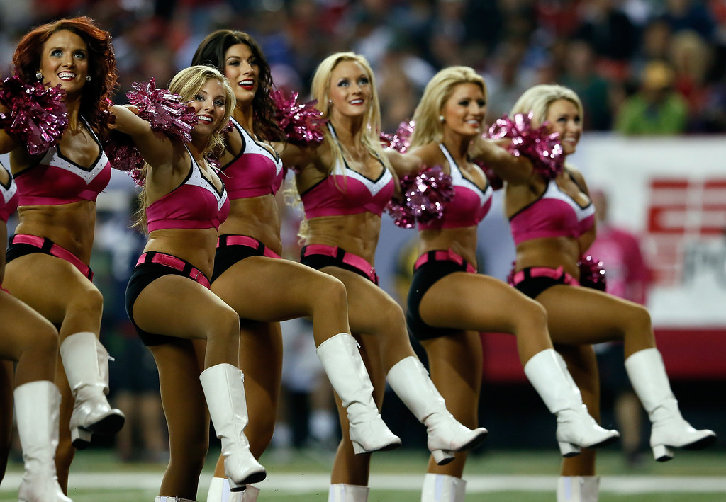 . Atlanta Falcons cheerleaders wear pink in honor of Breast Cancer Awareness month before a game between the Atlanta Falcons and the New York Jets at the Georgia Dome on October 7, 2013 in Atlanta, Georgia.  (Photo by Kevin C. Cox/Getty Images)