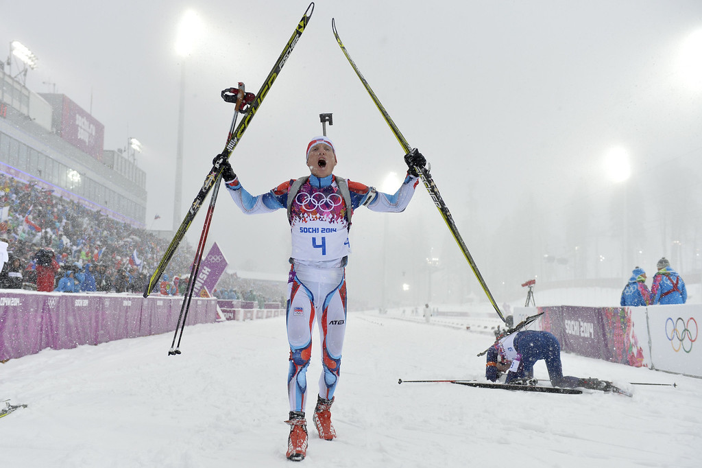 . Czech Republic\'s Ondrej Moravec (4) reacts as he wins bronze in the Men\'s Biathlon 15 km Mass Start at the Laura Cross-Country Ski and Biathlon Center during the Sochi Winter Olympics on February 18, 2014, in Rosa Khutor, near Sochi. ODD ANDERSEN/AFP/Getty Images