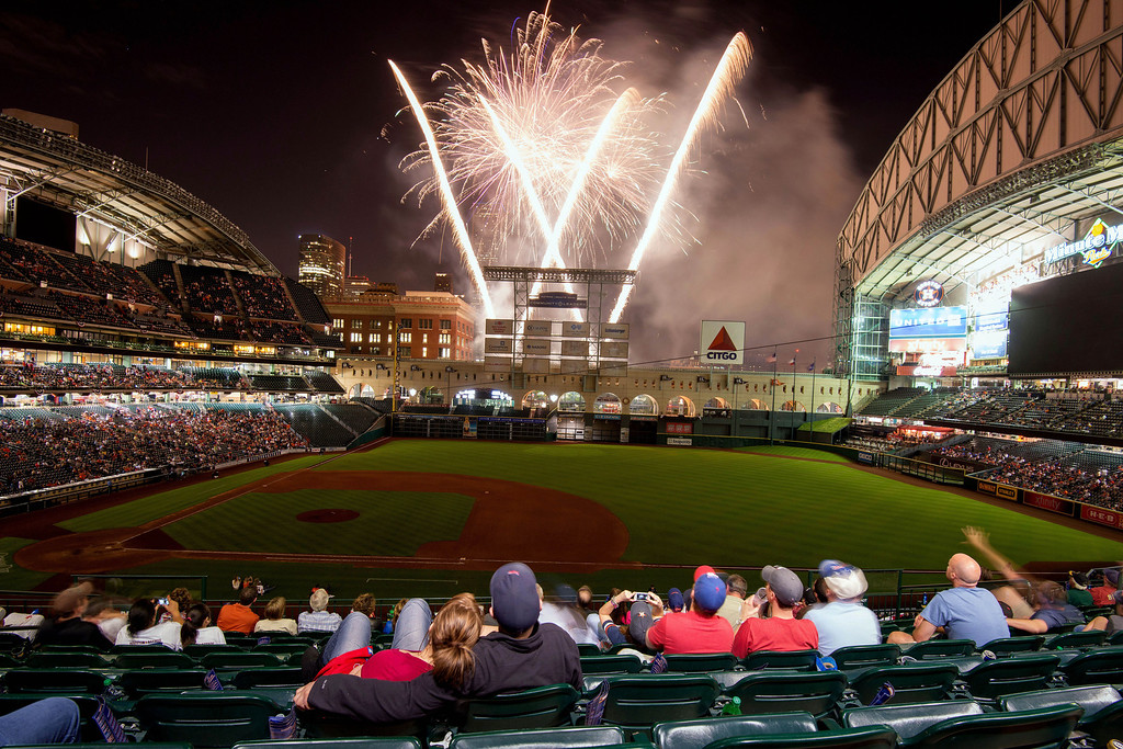 . Melissa Bull and Byron Wilcher watch as fireworks explode following the Houston Astros\' 8-2 win over the Texas Rangers in a season-opening baseball game at Minute Maid Park, Sunday, March 31, 2013, in Houston. (AP Photo/Houston Chronicle, Smiley N. Pool)