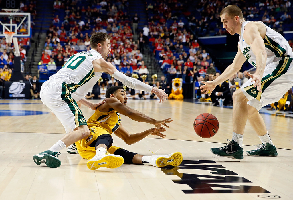. LEXINGTON, KY - MARCH 21:  Phil Pressey #1 of the Missouri Tigers tries to pass the ball against Pierce Hornung #4 and Wes Eikmeier #10 of the Colorado State Rams during the second round of the 2013 NCAA Men\'s Basketball Tournament at the Rupp Arena on March 21, 2013 in Lexington, Kentucky.  (Photo by Kevin C. Cox/Getty Images)