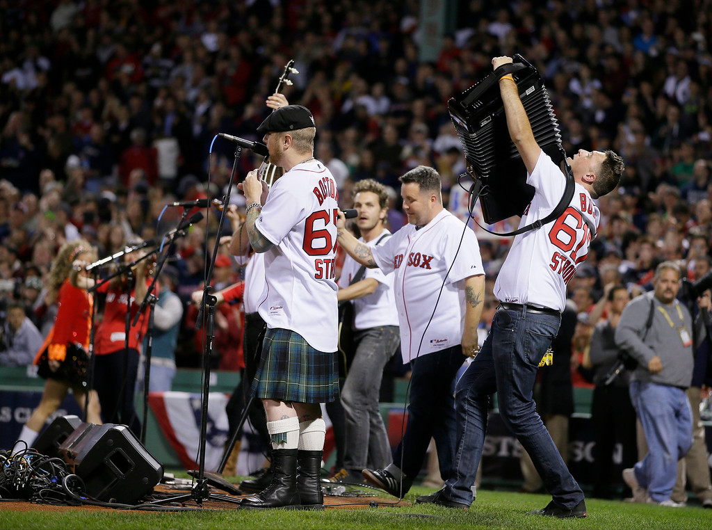 . The Dropkick Murphys perform the national anthem before Game 6 of the American League baseball championship series between the Boston Red Sox and the Detroit Tigers on Saturday, Oct. 19, 2013, in Boston. (AP Photo/Matt Slocum)