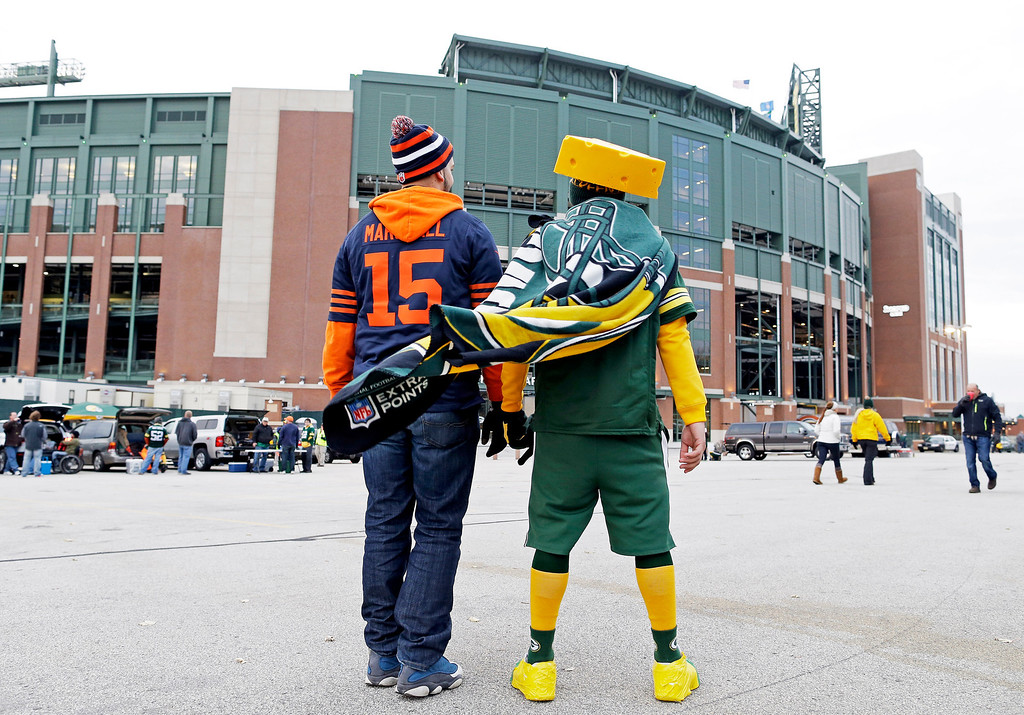 . Fans make their way to Lambeau Field before NFL football game between the Green Bay Packers and the Chicago Bears Monday, Nov. 4, 2013, in Green Bay, Wis. (AP Photo/Jeffrey Phelps)