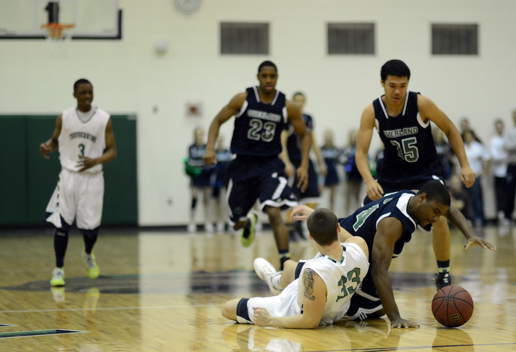 . HIGHLANDS RANCH, CO. - MARCH 02: Peter Howell of ThunderRidge High School #33 was stolen the ball by Aujonte Roper of Overland High School #4 during the 2nd round of 5A playoff game at ThunderRidge High School. March 2, 2013. Highlands Ranch , Colorado. ThunderRidge won 67-57. (Photo By Hyoung Chang/The Denver Post)