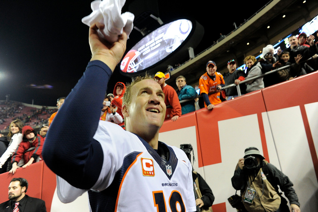 . Denver Broncos quarterback Peyton Manning (18) tosses up his towel in the tunnel after their win over the Kansas City Chiefs 35-28 December 1, 2013 at Arrowhead Stadium.  (Photo by John Leyba/The Denver Post)