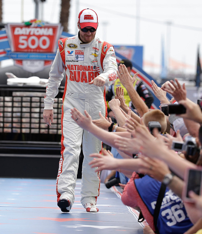 . Driver Dale Earnhardt Jr greets fans as he is introduced before the NASCAR Daytona 500 Sprint Cup series auto race at Daytona International Speedway in Daytona Beach, Fla., Sunday, Feb. 23, 2014. (AP Photo/John Raoux)