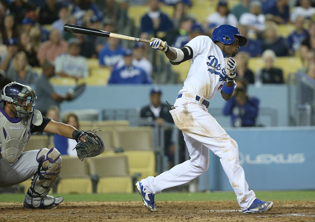 . LOS ANGELES, CA - JUNE 16:  Dee Gordon #9 of the Los Angeles Dodgers hits a single in the sixth inning during the MLB game against the Colorado Rockies at Dodger Stadium on June 16, 2014 in Los Angeles, California.  (Photo by Victor Decolongon/Getty Images)