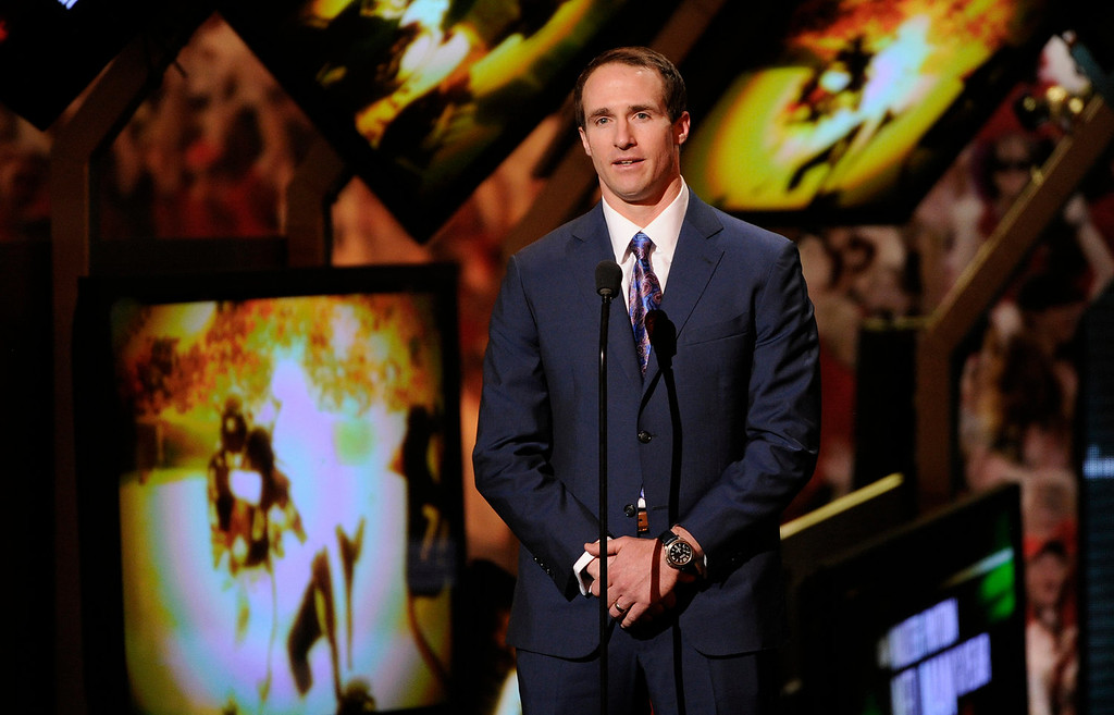 . Drew Brees of the New Orleans Saints speaks on stage at the third annual NFL Honors at Radio City Music Hall on Saturday, Feb. 1, 2014, in New York. (Photo by Evan Agostini/Invision for NFL/AP Images)