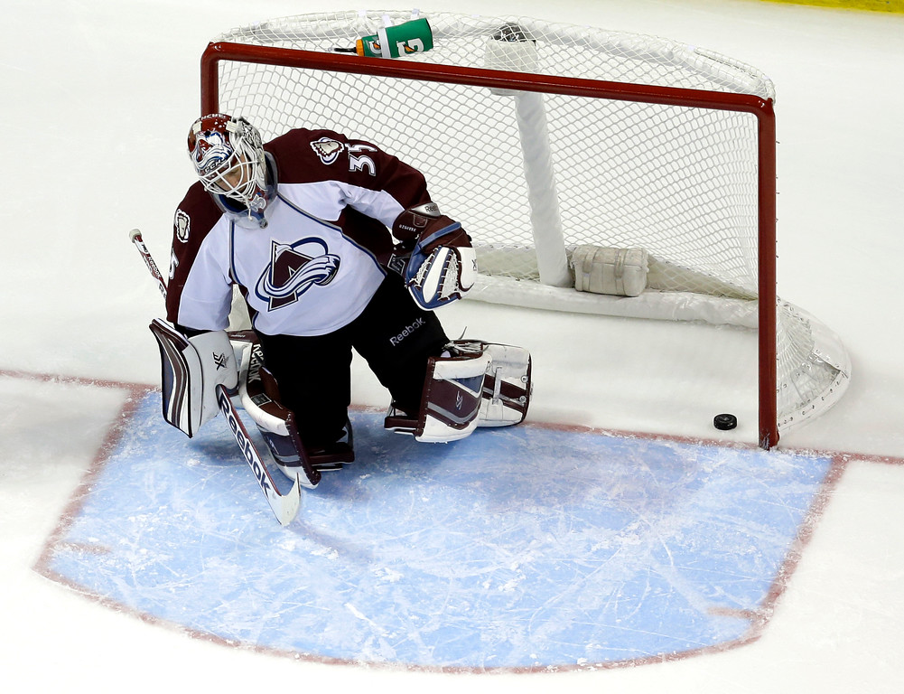 . Colorado Avalanche goalie Jean-Sebastien Giguere gets up slowly after giving up a goal to St. Louis Blues\' Alexander Steen during the third period of an NHL hockey game Thursday, Nov. 14, 2013, in St. Louis. It was the second goal of the game for Steen, helping the Blues to a 7-3 victory. (AP Photo/Jeff Roberson)
