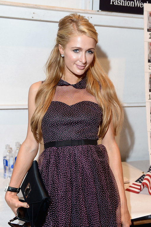 . NEW YORK, NY - SEPTEMBER 11:  Paris Hilton poses backstage at the Betsey Johnson fashion show during Mercedes-Benz Fashion Week Spring 2014 at The Studio at Lincoln Center on September 11, 2013 in New York City.  (Photo by Michael Loccisano/Getty Images for Mercedes-Benz Fashion Week Spring 2014)