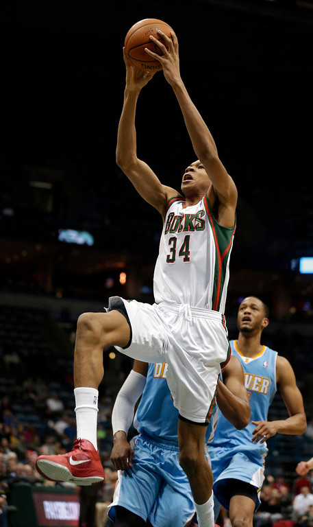 . Milwaukee Bucks\' Giannis Antetokounmpo (34) dunks against the Denver Nuggets during the second half of an NBA basketball game Thursday, Feb. 20, 2014, in Milwaukee. (AP Photo/Jeffrey Phelps)