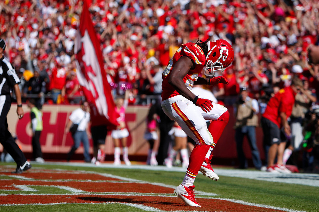 . Jamaal Charles #25 of the Kansas City Chiefs celebrates after scoring a touchdown in the third quarter against the Oakland Raiders October 13, 2013 at Arrowhead Stadium in Kansas City, Missouri. (Photo by Kyle Rivas/Getty Images)