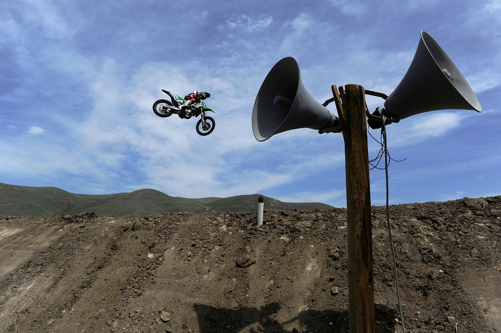 . LAKEWOOD, CO - MAY 23:  Local professional motocross rider, Derek Anderson, from Arvada Colorado, launches off a jump on course  during a practice run on media day at the AMA Thunder Valley National at the Thunder Valley Motocross Park in Lakewood Colorado, Thursday May 23, 2013. The main AMA event is this Saturday at Thunder Valley. (Photo By Andy Cross/The Denver Post)