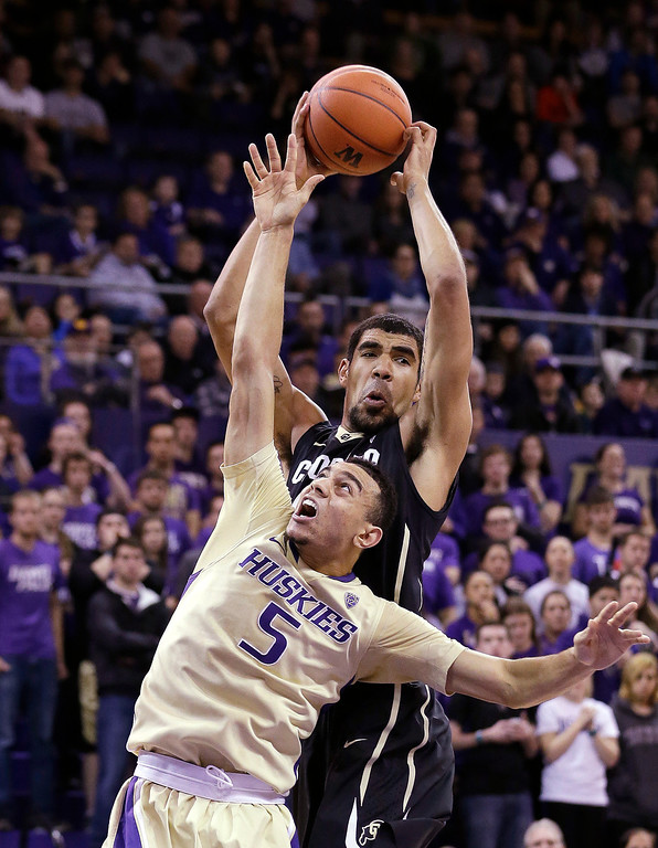 . Washington\'s Nigel Williams-Goss (5) falls short of a rebound to Colorado\'s Josh Scott in the first half of an NCAA men\'s basketball game Sunday, Jan. 12, 2014, in Seattle. (AP Photo/Elaine Thompson)