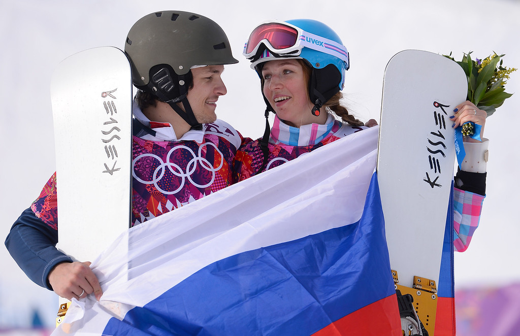 . SOCHI, RUSSIA - FEBRUARY 19:  Men\'s gold medalist Vic Wild of Russia and women\'s bronze medalist Alena Zavarzina of Russia celebrate after the Snowboard Parallel Giant Slalom Finals on day twelve of the 2014 Winter Olympics at Rosa Khutor Extreme Park on February 19, 2014 in Sochi, Russia.  (Photo by Lars Baron/Getty Images)