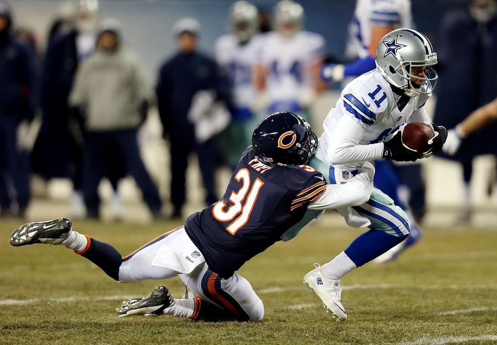 . Wide receiver Cole Beasley #11 of the Dallas Cowboys is tackled by cornerback Isaiah Frey #31 of the Chicago Bears during a game at Soldier Field on December 9, 2013 in Chicago, Illinois.  (Photo by Jonathan Daniel/Getty Images)