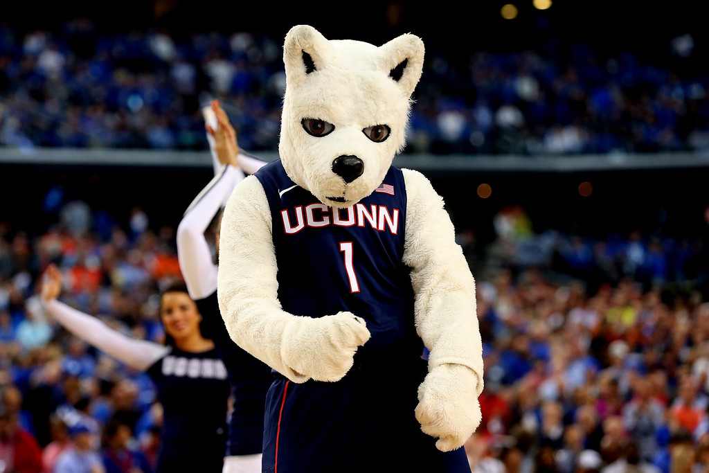. ARLINGTON, TX - APRIL 05: The Connecticut Huskies mascot, Jonathan the Husky, performs before the NCAA Men\'s Final Four Semifinal against the Florida Gators at AT&T Stadium on April 5, 2014 in Arlington, Texas.  (Photo by Ronald Martinez/Getty Images)