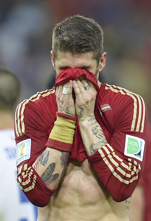 . Spain\'s defender Sergio Ramos reacts during a Group B football match between Spain and Chile in the Maracana Stadium in Rio de Janeiro during the 2014 FIFA World Cup on June 18, 2014. (LLUIS GENE/AFP/Getty Images)