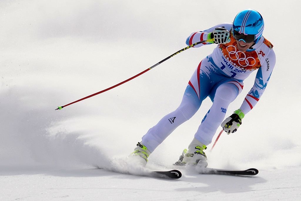 . SOCHI, RUSSIA - FEBRUARY 09: Gold medalist Matthias Meyer turns in a 2:06:23 run during the alpine skiing men\'s downhill final. Sochi 2014 Winter Olympics at the Rosa Khutor Alpine Resort on Sunday, February 9, 2014. (Photo by AAron Ontiveroz/The Denver Post)