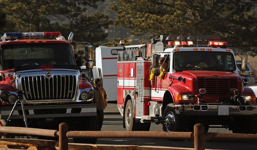 . Wildland firefighter crews from South Metro arrive at the   Moraine Park Vistor\'s Center to help protect the structure just in case the fire reaches the building on December 2nd, 2012. The Fern Lake Fire, which has been burning in Rocky Mountain National Park since October, kicked up yesterday and forced the evacuation of hundreds of homes east of the fire. Helen H. Richardson, The Denver Post