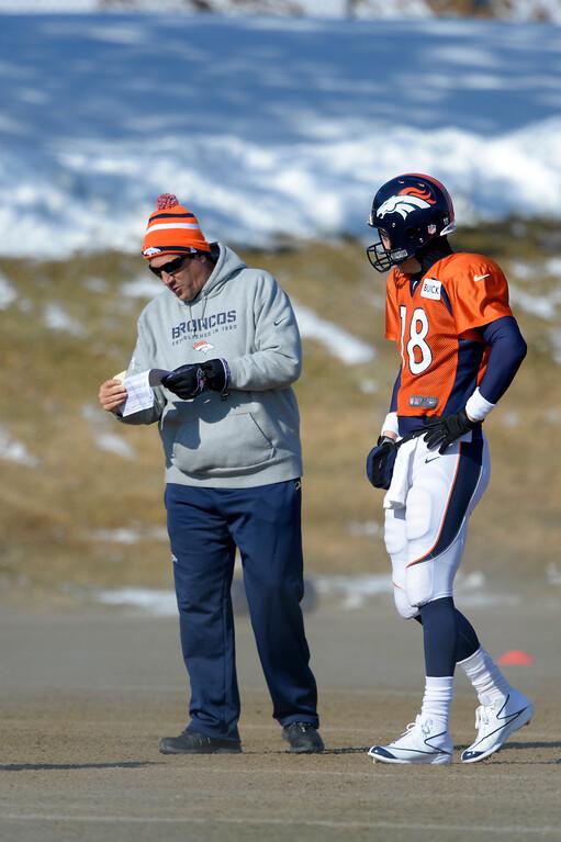 . Denver Broncos quarterback Peyton Manning (18) with quarterbacks coach Greg Knapp during practice January 23, 2014 at Dove Valley.   (Photo by John Leyba/The Denver Post)