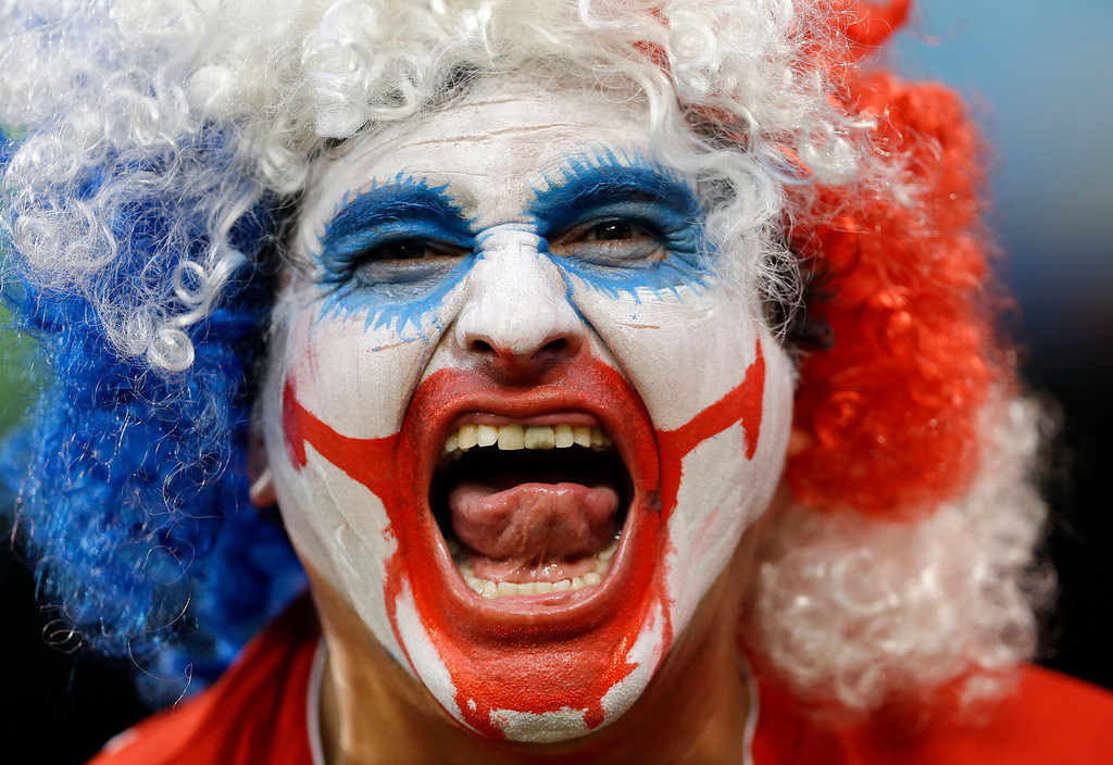 . A spectator from Chile yells before the group B World Cup soccer match between Chile and Australia in the Arena Pantanal in Cuiaba, Brazil, Friday, June 13, 2014.  (AP Photo/Kirsty Wigglesworth)