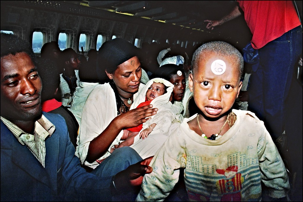 ". ON BOARD OF ISRAELI PLANE:Ethiopian Jews known as ""Falashas\"" sit on bard of an Israeli Air Force Boeing 707, during their transfer from Addis Ababa to Tel Aviv early 25 May 1991. Sixteen thousand five hundred \""Falashas\"" were evacuated from Ethiopia as part of \""Operation Solomon\"", the world\'s largest airlift carried out out by Israeli army. The large numbers of emigrants from Ethiopia and, primarily, from the Soviet Union, increased Israel\'s population by nearly 10 % in 3 years (between 1989-92). PATRICK BAZ/AFP/Getty Images"