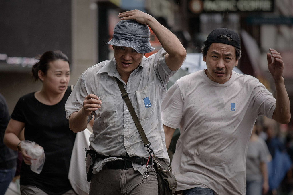 . Pedestrians walk against strong winds in Hong Kong on August 13, 2013 as the city braces for deadly Typhoon Utor which earlier swept through the Philippines. The strongest typhoon to hit the Philippines caused floods and landslides, killing at least two people as rescuers raced to reach isolated villages in the storm\'s path.   PHILIPPE LOPEZ/AFP/Getty Images