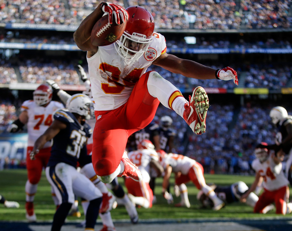 . Kansas City Chiefs running back Knile Davis, center, jumps in the end zone as he scores a touchdown against the San Diego Chargers during the first half of an NFL football game, Sunday, Dec. 29, 2013, in San Diego. (AP Photo/Lenny Ignelzi)