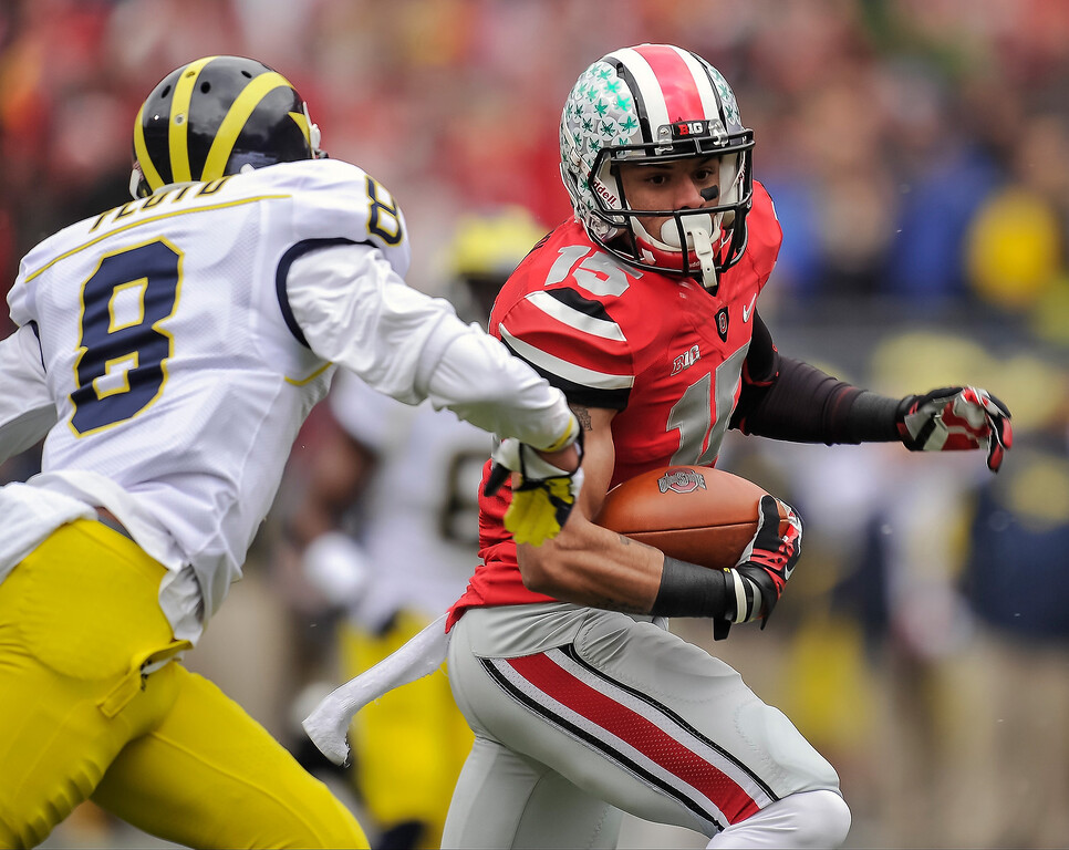 . Devin Smith #15 of the Ohio State Buckeyes runs with the ball against the Michigan Wolverines at Ohio Stadium on November 24, 2012 in Columbus, Ohio. (Photo by Jamie Sabau/Getty Images)