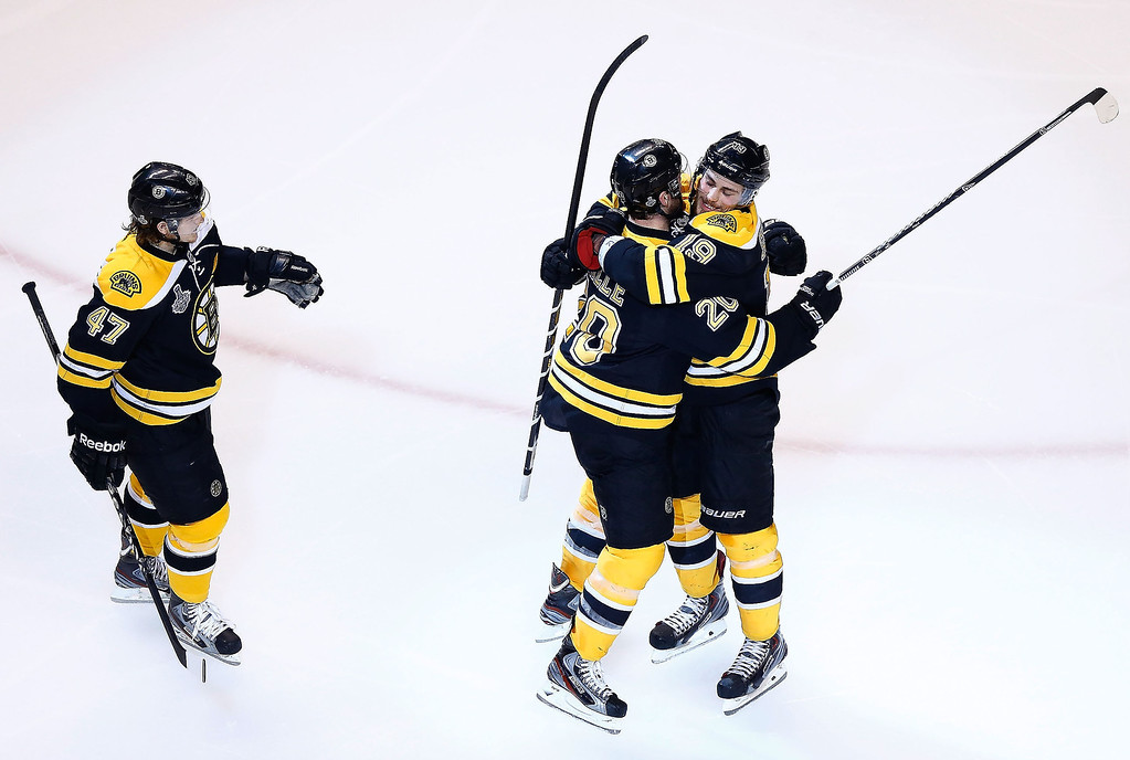 . Daniel Paille #20 of the Boston Bruins is congratulated by teammates Torey Krug #47 and Tyler Seguin #19 after scoring a goal in the second period against the Chicago Blackhawks during Game Three of the Stanley Cup Final on June 17, 2013 at TD Garden in Boston, Massachusetts.  (Photo by Jared Wickerham/Getty Images)