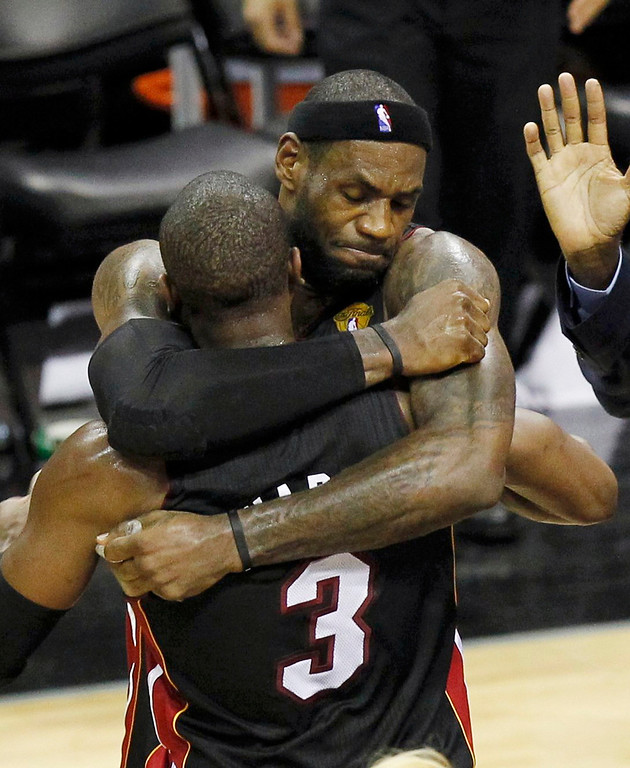 . Miami Heat\'s LeBron James hugs teammate Dwyane Wade after the Heat defeated the San Antonio Spurs in Game 4 of their NBA Finals basketball series in San Antonio, Texas June 13, 2013. REUTERS/Mike Stone