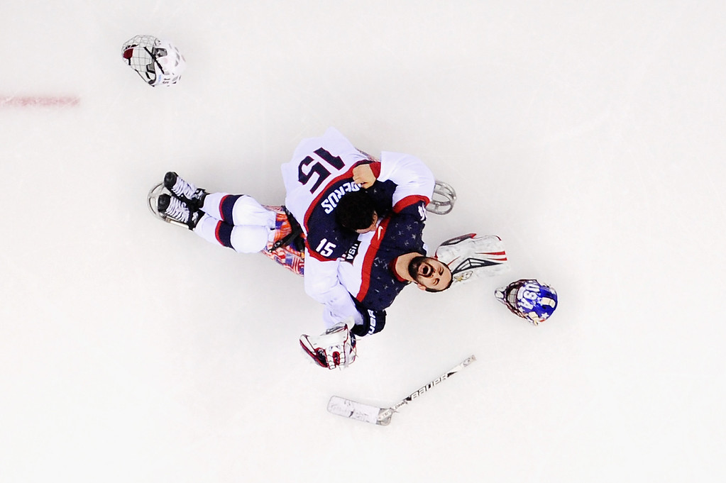 . Steve Cash of the United States celebrates winning the gold medal with Nikko Landeros after the Ice Sledge Hockey Gold Medal game between the United States and Russia on day eight of the Sochi 2014 Paralympic Winter Games at Shayba Arena on March 15, 2014 in Sochi, Russia.  (Photo by Dennis Grombkowski/Getty Images)
