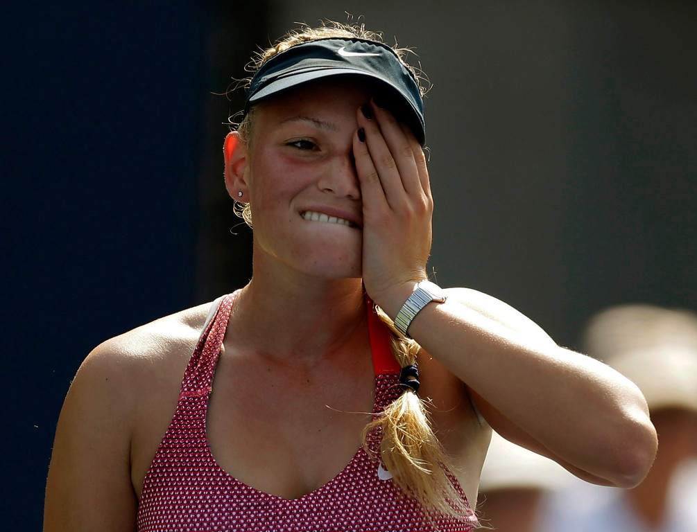 . Donna Vekic, of Croatia, reacts during a second round match against  Simona Halep, of Romania, at the 2013 U.S. Open tennis tournament, Thursday, Aug. 29, 2013, in New York. (AP Photo/Darron Cummings)